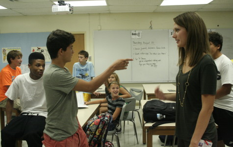 Amy Blakemore (right) and a student (left) act out during a class discussion.