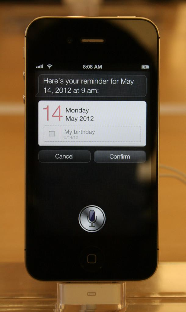 Siri, the iPhones voice recognition service, being used to remind the user of a birthday