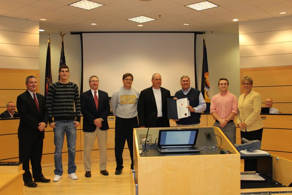 The football team was honored at the Lenexa City Council meeting on December 4, 2012 for their 6A state championship win. Mayor of Lenexa, Michael Boehm, senior captain Alec Dinges, assistant coach John Stonner, head coach Tim Callaghan, principal Dr. Charles McLean, senior captain Joel Spiller, Lenexa Ward 4 City Council member Mandy Stuke.