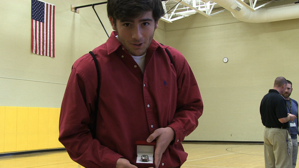 Senior Robert Rice shows off his State Champs Ring.