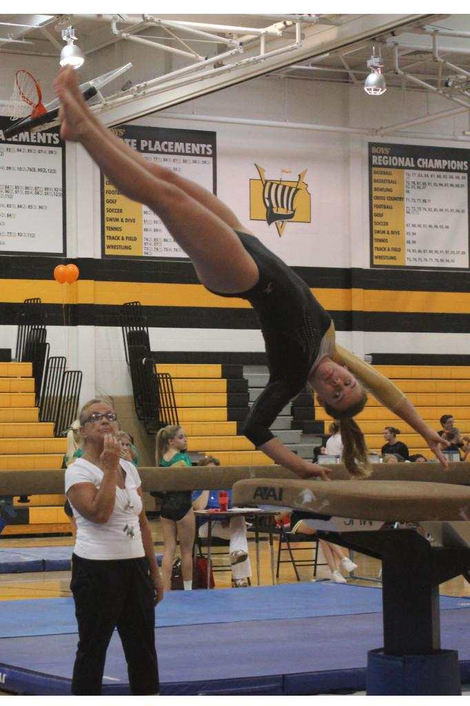 Senior, Paige Parker competing on vault.