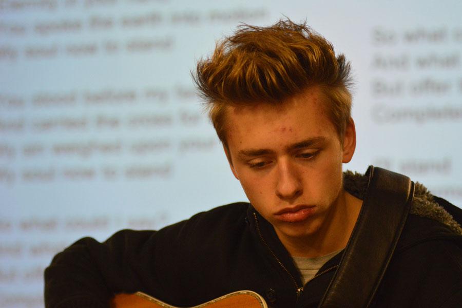 Freshman Jordan Mills plays guitar at Club 121