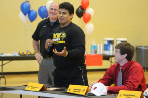 Marquan Osbey signed to play football at Fort Scott.