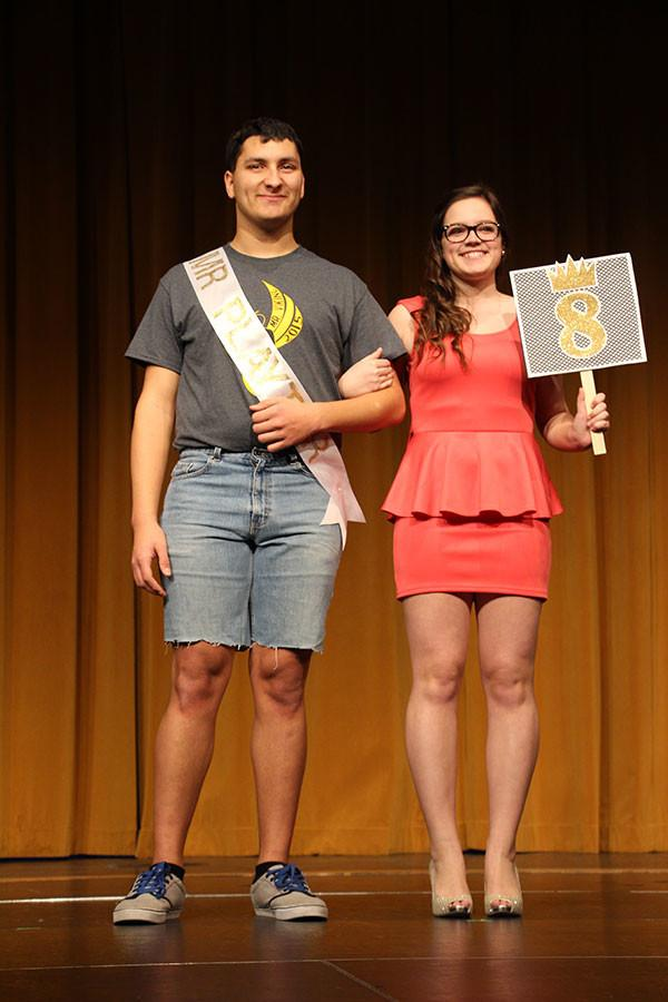 Pageant contestants strut across the stage with their escorts during the opening of the Mr. Viking pageant.