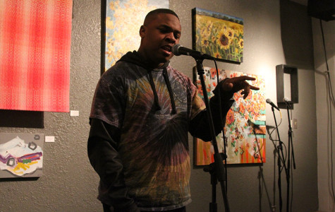 Junior Julius Maddox performs his poetry at the Louder Than a Bomb KC competition.