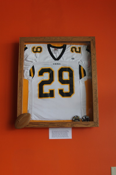 Andre's framed jersey hangs on the wall of Cafe 29 next to his future KU jersey. Photo by Kelsea Lilla.