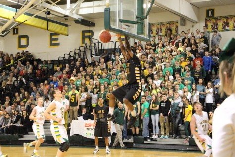 Senior Darrell Stewart hangs on the rim after a dunk.