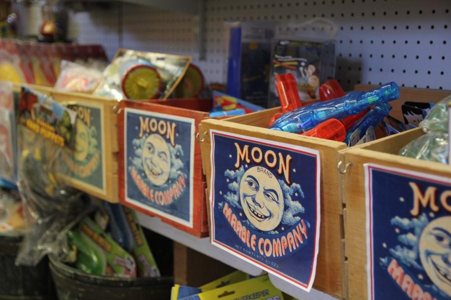 Trays of assorted toys at The Moon Marble Company. Photo by Jenna Wilson.