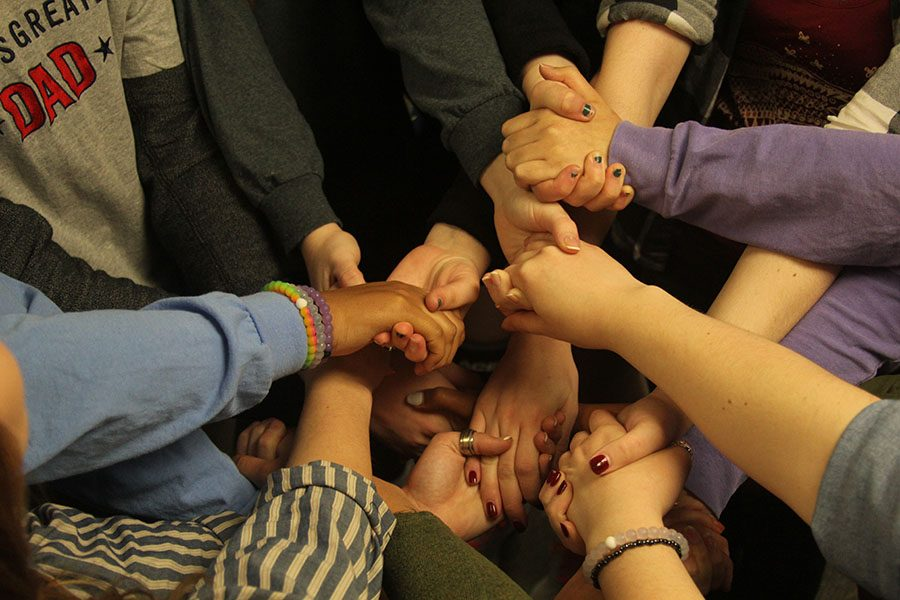 Journalism+students+hold+hands+in+a+team-bonding+exercise+called+the+human+knot%2C+which+helped+the+class+learn+to+work+together+to+untangle+themselves+and+improved+their+communication+skills+to+help+them+in+future+class+assignments.+
