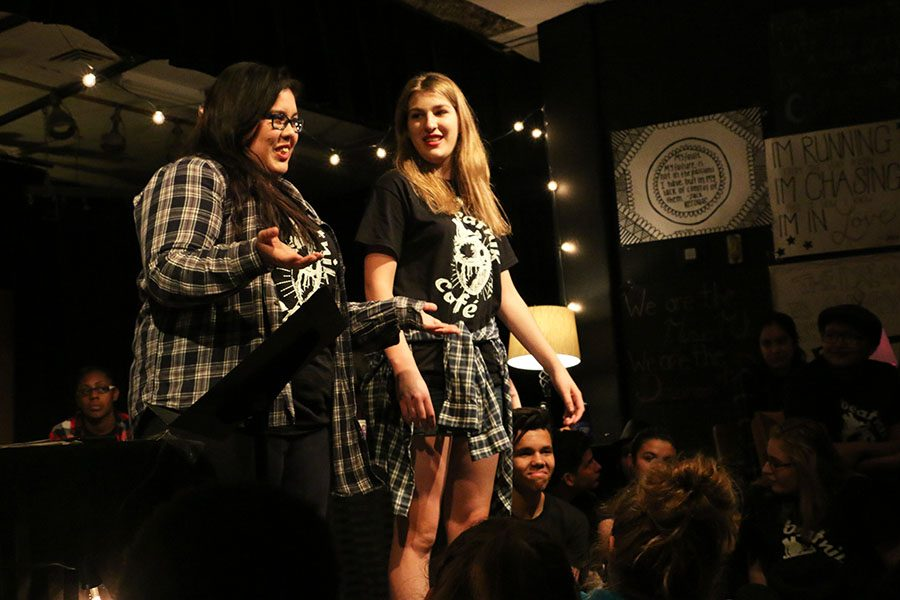 Seniors Courtney Johnson and Jocilyn Sarsozo perform an original collaborative poem at Beatnik Cafe on April 22nd.
