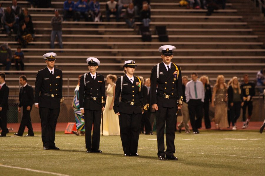 Cadets standing at attention at the 2015 homecoming game