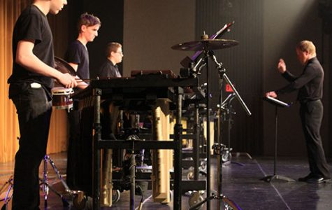 Sean Perkins and other percussionists play the xylophone.