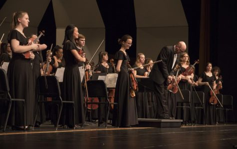 Mr. Mulvenon bows after Shawnee Mission West's performance