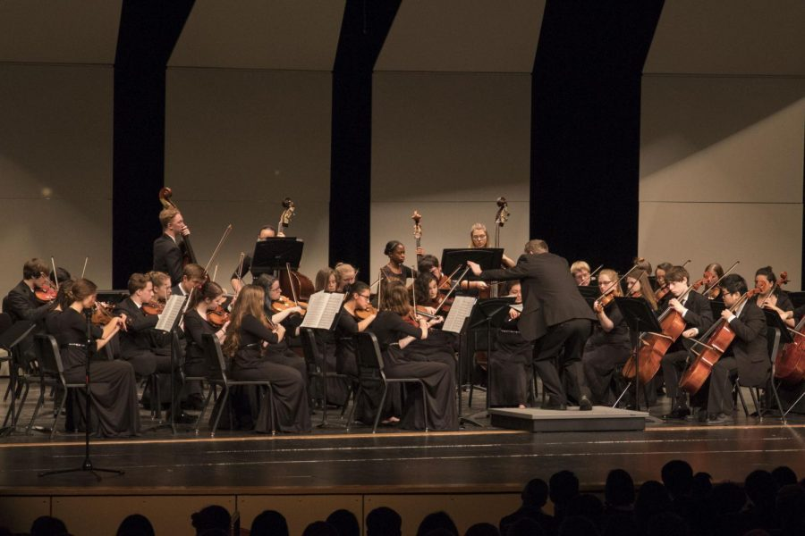 Mr. Wiebe passionately conducts Shawnee Mission South's orchestra