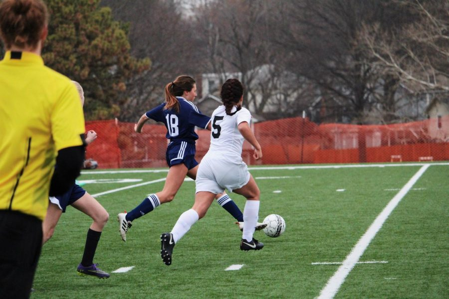 #5, Naomi Oliva, attempts to steal the ball from BVN.