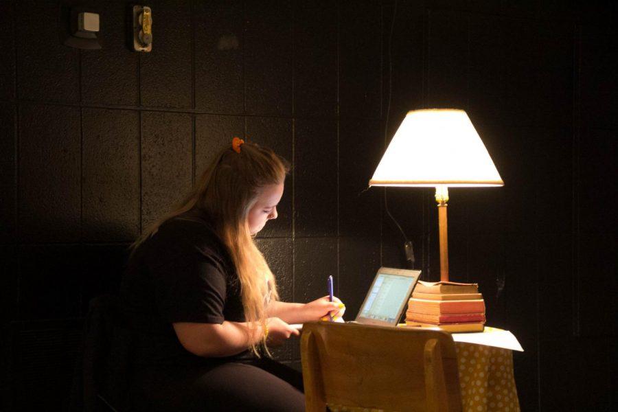 Senior Paige Kring works at a desk before Beatnik starts.