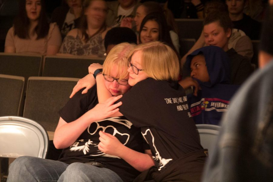 Seniors Callie and Julie sharing a hug after Julie's performance.