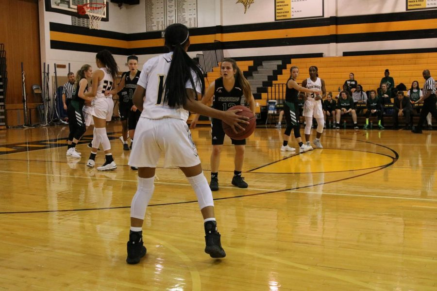 Sophomore Jasmine Patterson gets possession of the ball.