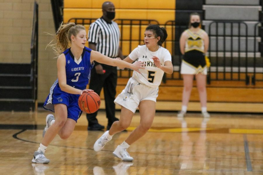 Aaliyah Garcia plays defense against Liberty High School during a Varsity Girls Basketball game. Photo taken by Morgan Brewer.