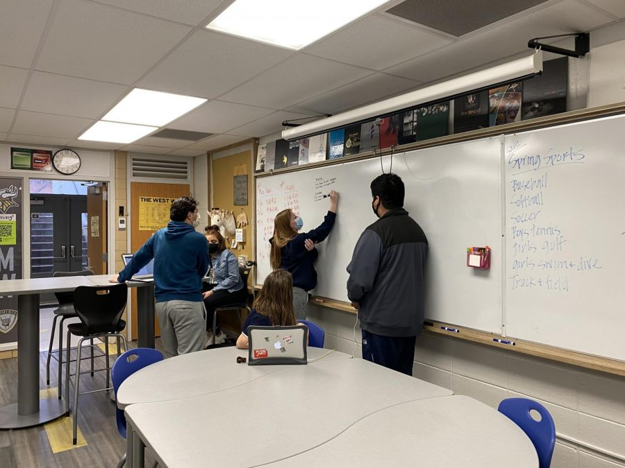 Students brainstorm on the board during class. Photo taken by Amy Morgan.